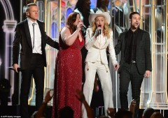 Macklemore (L), Ryan Lewis (2nd R), Mary Lambert (2nd L), Madonna (C) embrace on stage after performing the song 'Same Love' while Queen Latifah officiated over a mass wedding at the Grammy Awards. photos courtesy Daily Mail.com