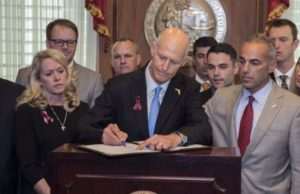 Florida Governor Signs Gun Bill, NRA Sues