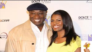 """Michael Clarke Duncan and Omarosa Manigault"""
